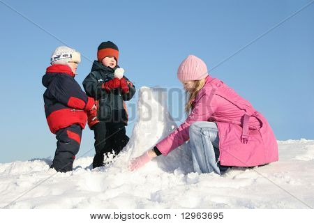 mother with children play on snow