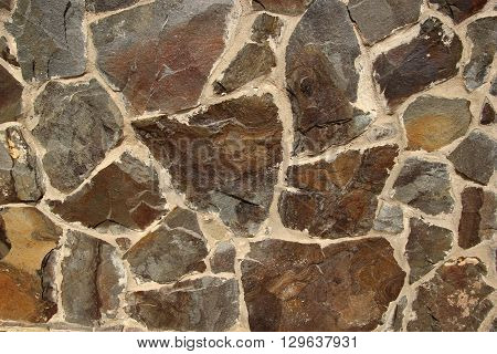 Stone texture made of different shape stones. Realistic stone pattern for exterior design purposes