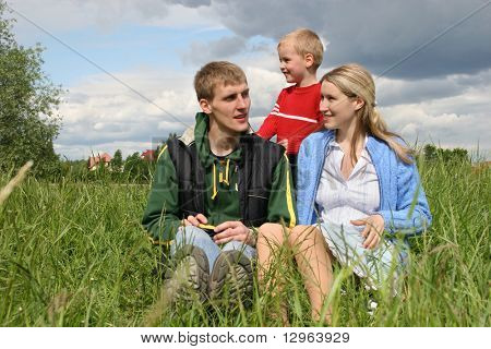 family on meadow waiting next child