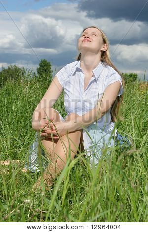woman sit on grass after storm