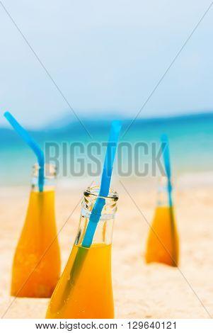 Orange Juice Bottles Beach Sea Background Holiday