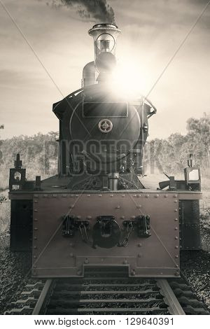 Picture of a steam engine train at the rail shot with vintage effect