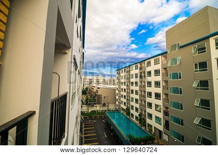 Background of the modern building condominium with swimming pool