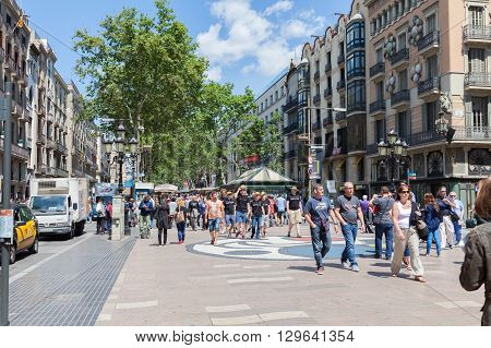 BARCELONA SPAIN-MAY 13 2016: Barcelona is the capital of the autonomous community of Catalonia in Spain city. Crowd of people visit the Rambla de Barcelona Spain.