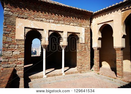 MALAGA, SPAIN - JULY 11, 2008 - Patio aside Torre de Maldonado within the Nasrid Palace Malaga castle (Alcazaba de Malaga) Malaga Malaga Province Andalucia Spain Western Europe, July 11, 2008.