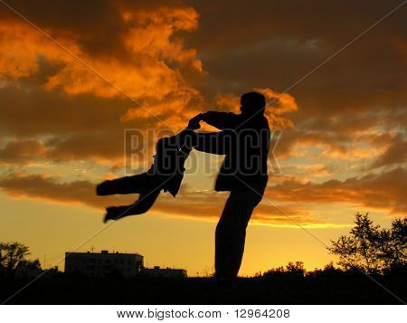 father rotate son sunset