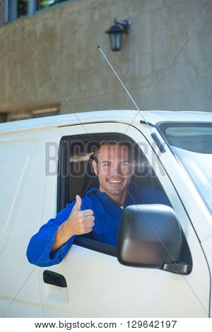 Portrait of mechanic sitting in his car