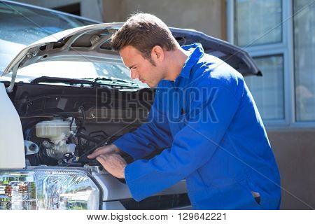 Mechanic examining the car at the repair garage