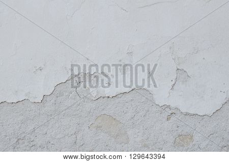 Cracked concrete vintage wall background old wall texture. Stone texture in black and white colors. Concrete texture background. White grunge wall background.