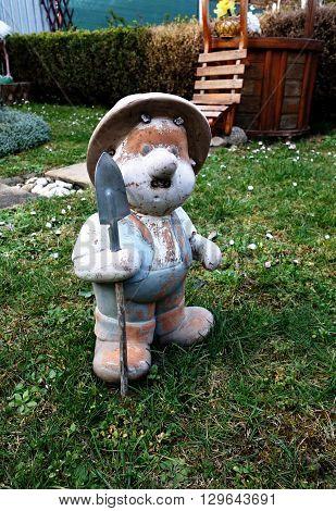 garden gnome with a shovel on grass