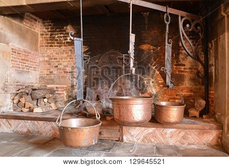 Varengeville sur Mer France - july 16 2015 : the Ango manor built between 1530 and 1545 for Jean Ango the Dieppe governor. cooking pot in a fire place