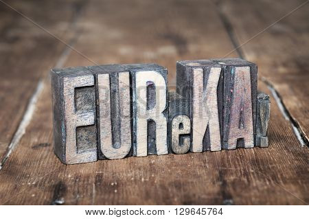 eureka exclamation made from wooden letterpress type on grunge wood