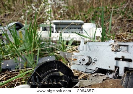 discarded electronic appliances free standing in nature