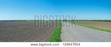 Panoramic photography of European steppe landscape at the time of spring planting