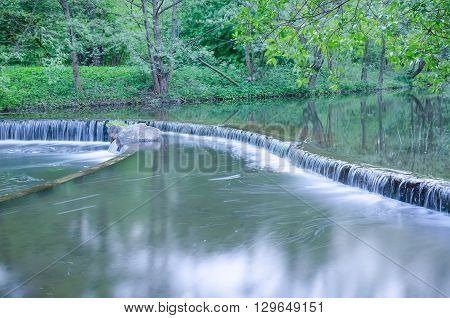 Small Waterfall On A Small Picturesque Brook In The Forest