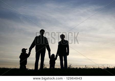 family of four on sky