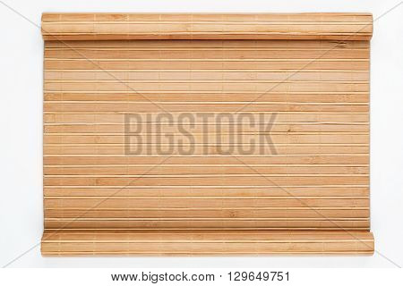 Bamboo mat twisted in the form of a manuscript on a white background