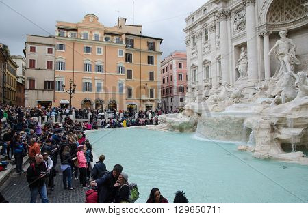 ROME, ITALY  APRIL 26: Lot of tourists at the famous Fontana di Trevi in Rome Italy April 26, 2016