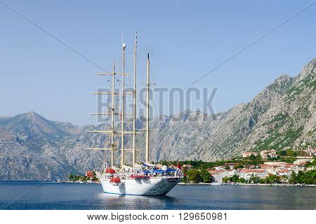 Yacht in the Bay of Kotor on the background of the city and mountains Kotor Montenegro