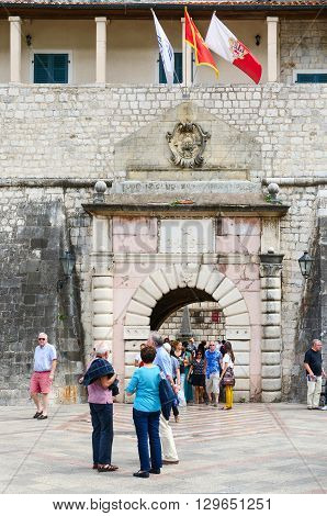 KOTOR MONTENEGRO - SEPTEMBER 21 2015: Unidentified tourists are at Sea (Western) gate (1555) Kotor Montenegro