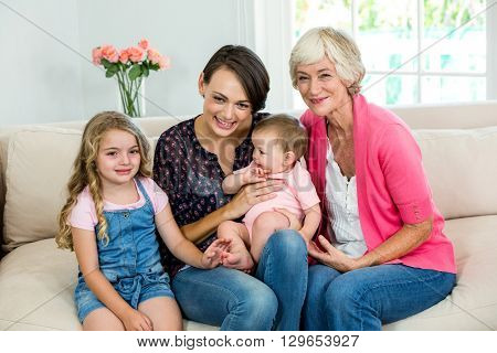 Happy multi generation family with baby while sitting at home