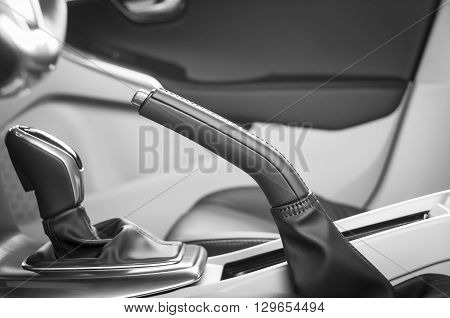 car interior transmission closeup with leather stitch