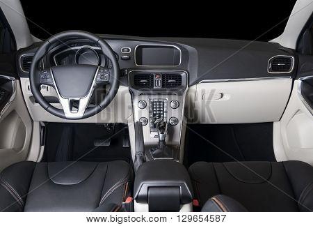 Dark luxury car Interior - steering wheel, shift lever and dashboard