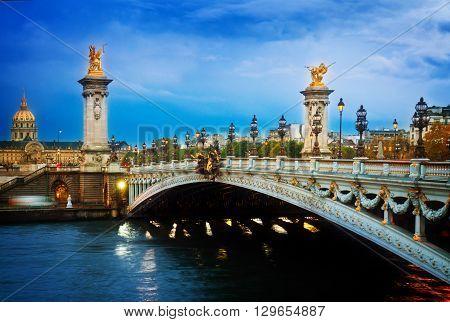famouse Alexandre III Bridge at night,  Paris, France, retro toned