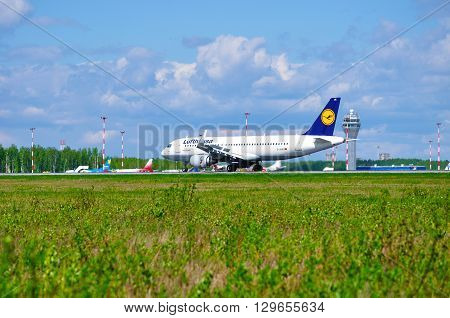 SAINT PETERSBURG RUSSIA - MAY 11 2016. Lufthansa Airbus A320 airplane -registration number D-AIUK- rides on the runway after arrival in Pulkovo International airport
