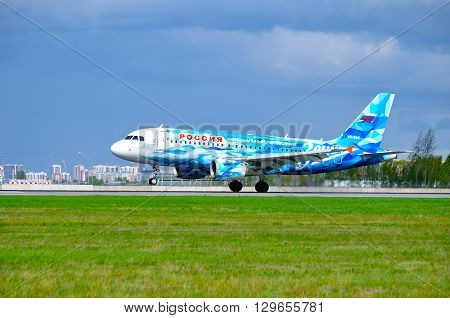 SAINT PETERSBURG RUSSIA - MAY 11 2016. Rossiya Airbus A319 aircraft with FC Zenit livery -registration number VQ-BAS- is riding on the runway after landing in Pulkovo International airport
