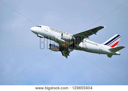 SAINT PETERSBURG RUSSIA - MAY 11 2016. Air France Airbus A319 aircraft -registration number F-GRHK- is flying in the sky after departure from Pulkovo International airport