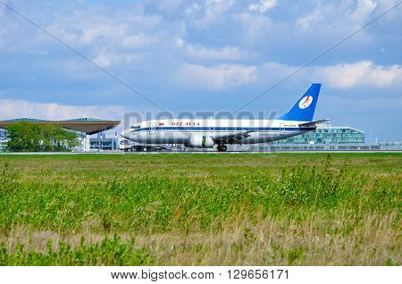 SAINT PETERSBURG RUSSIA - MAY 11 2016. Belavia Airlines Boeing 737 airplane-registration number EW-254PA - is riding on the runway after arrival in Pulkovo International airport