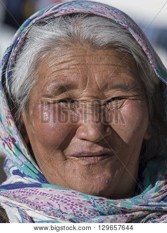LADAKH INDIA - SEPTEMBER 09 2014: Old unidentified local woman outdoor in Ladakh. The majority of the local population are descendant of Tibetan.