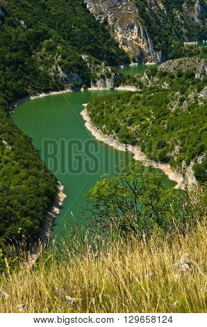 Detail of meanders at rocky river Uvac gorge on sunny morning, southwest Serbia