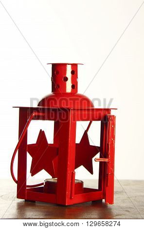 red decorative tealight candle holder in metal painted red