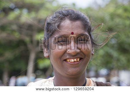 MATARA SRI LANKA - NOVEMBER 5 2014: Unknown Sri Lankan beggar woman waits for alms on a street