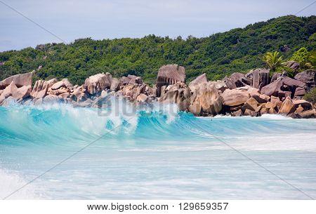 Seychelles, LaDigue Island beach, wild granite rocks and wavy sea