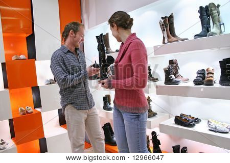 couple in shoes shop