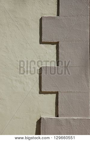 a picture of an exterior 1860's adobe building wall
