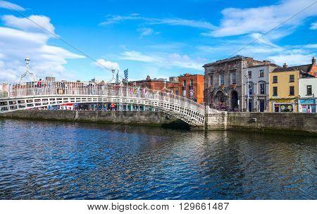 Dublin Ireland - July 31 2013: The Ha'penny bridge on the Liffey river Temple Bar district
