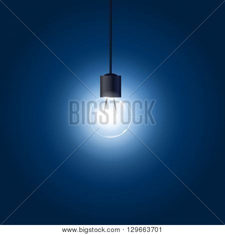 Light bulb hanging on cord on blue background