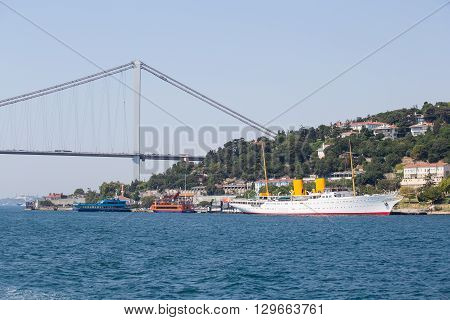 ISTANBUL TURKEY - JULY 29 2015 : White big cruise ship and water Bosphorus strait in Istanbul Turkey