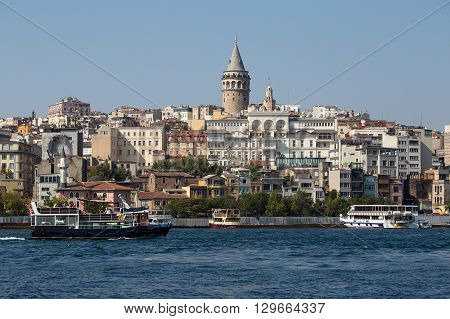 ISTANBUL TURKEY - JULY 29 2015 : Beyoglu district historic architecture and Galata tower medieval landmark over the Golden Horn in Istanbul Turkey
