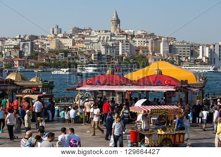 ISTANBUL TURKEY - JULY 29 2015 : Eminonu Harbor Beyoglu district historic architecture and sea port over the Golden Horn bay in Istanbul Turkey