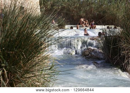 Locals And Tourists Swim In The Famous Hot Springs In Saturnia