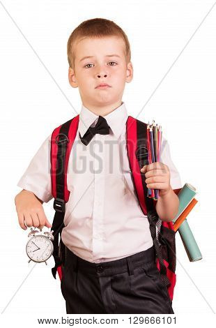 Caucasian schoolboy in a white shirt with a backpack isolated on white