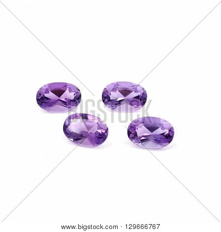 Brazilian Faceted Amethyst on a white background.