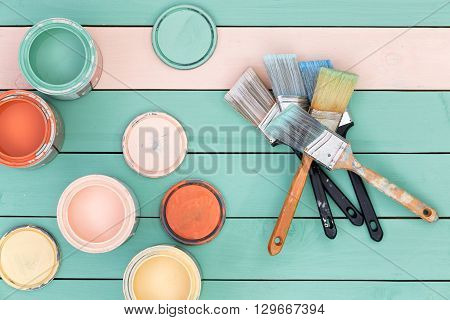Colorful Selection Of Wood Stains And Paintbrushes
