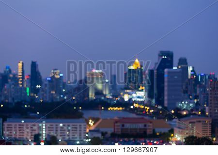 Abstract blurred bokeh light city downtown with blue sky background