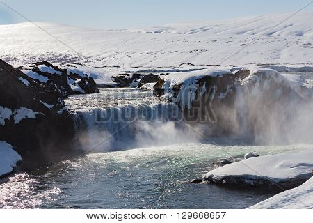 Natural waterfall in winter season, Iceland natural landscape background